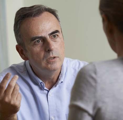 Depressed Mature Man Talking To Counselor